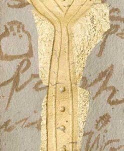 Cucchiaio color oro con dettagli in rilievo