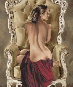 Ritratto di una ragazza con la schiena nuda su una poltrona