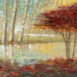 Albero con foglie rosse vicino a un laghetto