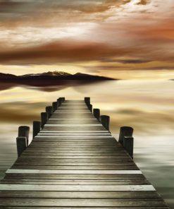 Fotografia di un pontile al tramonto con effetto sfumato
