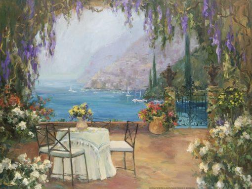Romantico tavolino circondato da fiori con vista mare