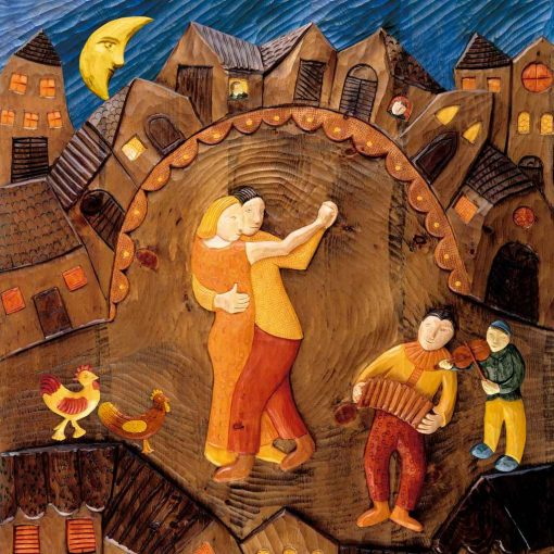 Coppia che balla in un borgo medievale