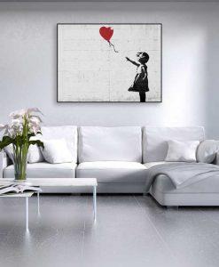 Murales del famoso artista Banksy: Bambina con palloncino