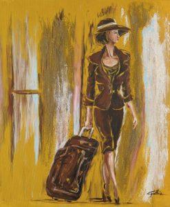 Donna elegante con valigia