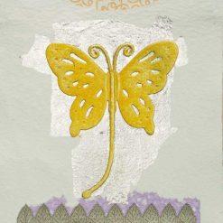 Silhouette di una farfalla gialla con dettagli color argento