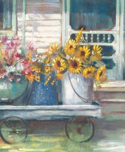 Vasi di fiori su un carretto in giardino